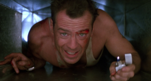Bruce willis as John McClane in 'Die Hard'